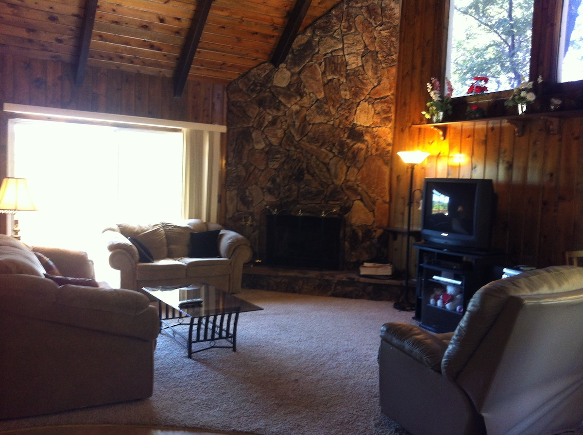 Living Room has Direct TV, Cable Modem for Internet with wireless WiFi router, and music system