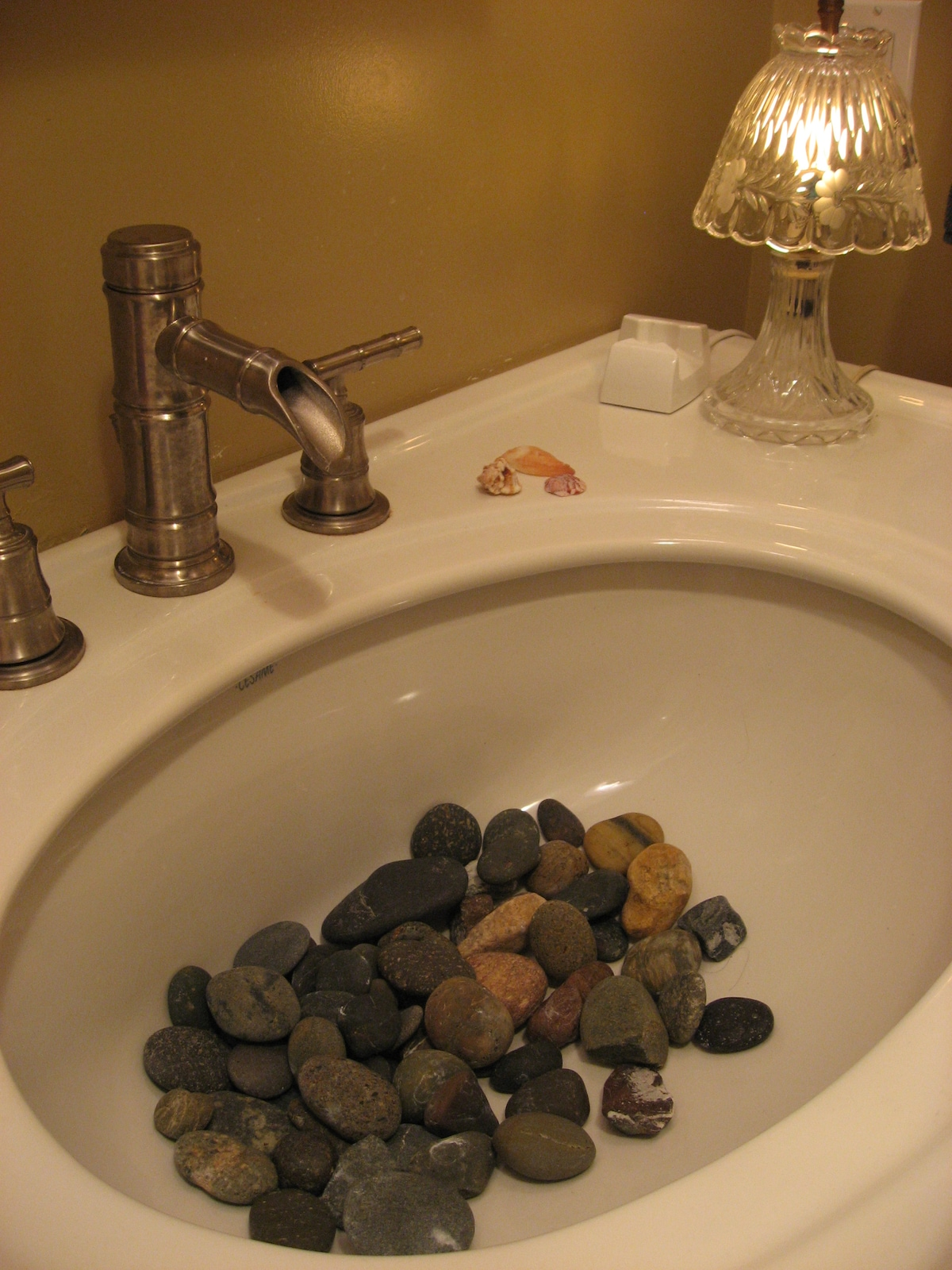 My kids like the aestetic of river rocks in the sink.  Sanitized often or moved if lots of sink use. :)