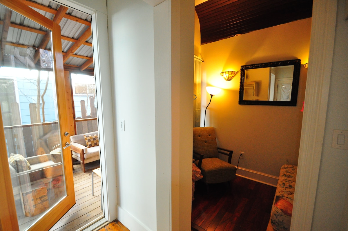 The screened in porch is connected in the room and is  private for room E guests.