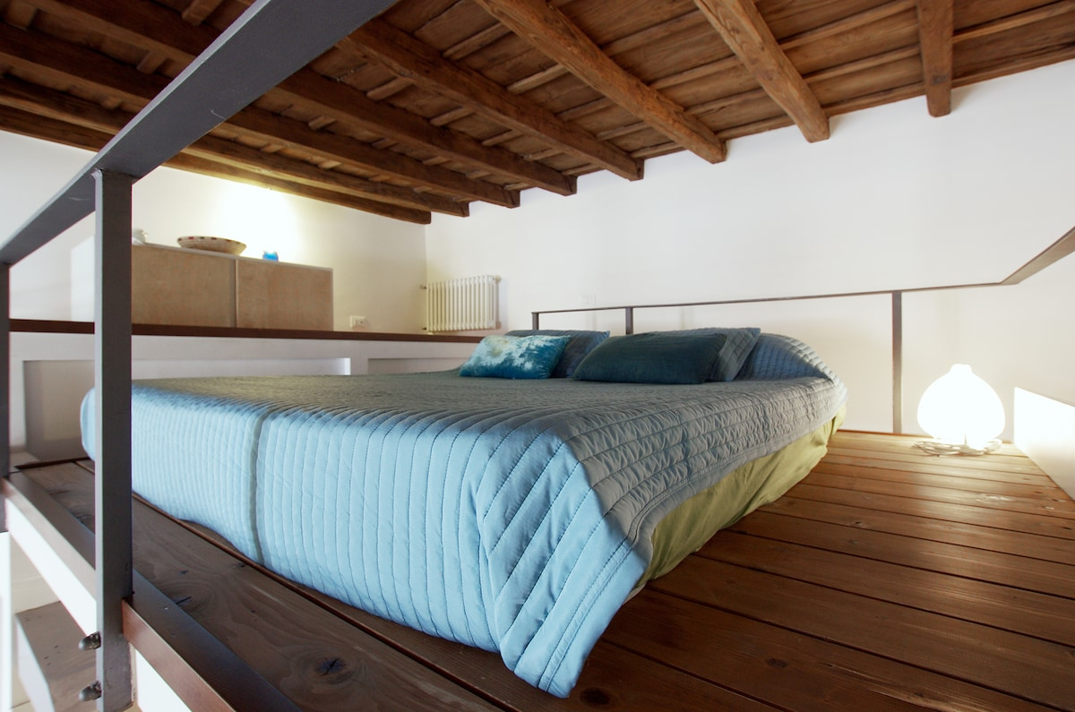 confortable double bed in the mezzanine