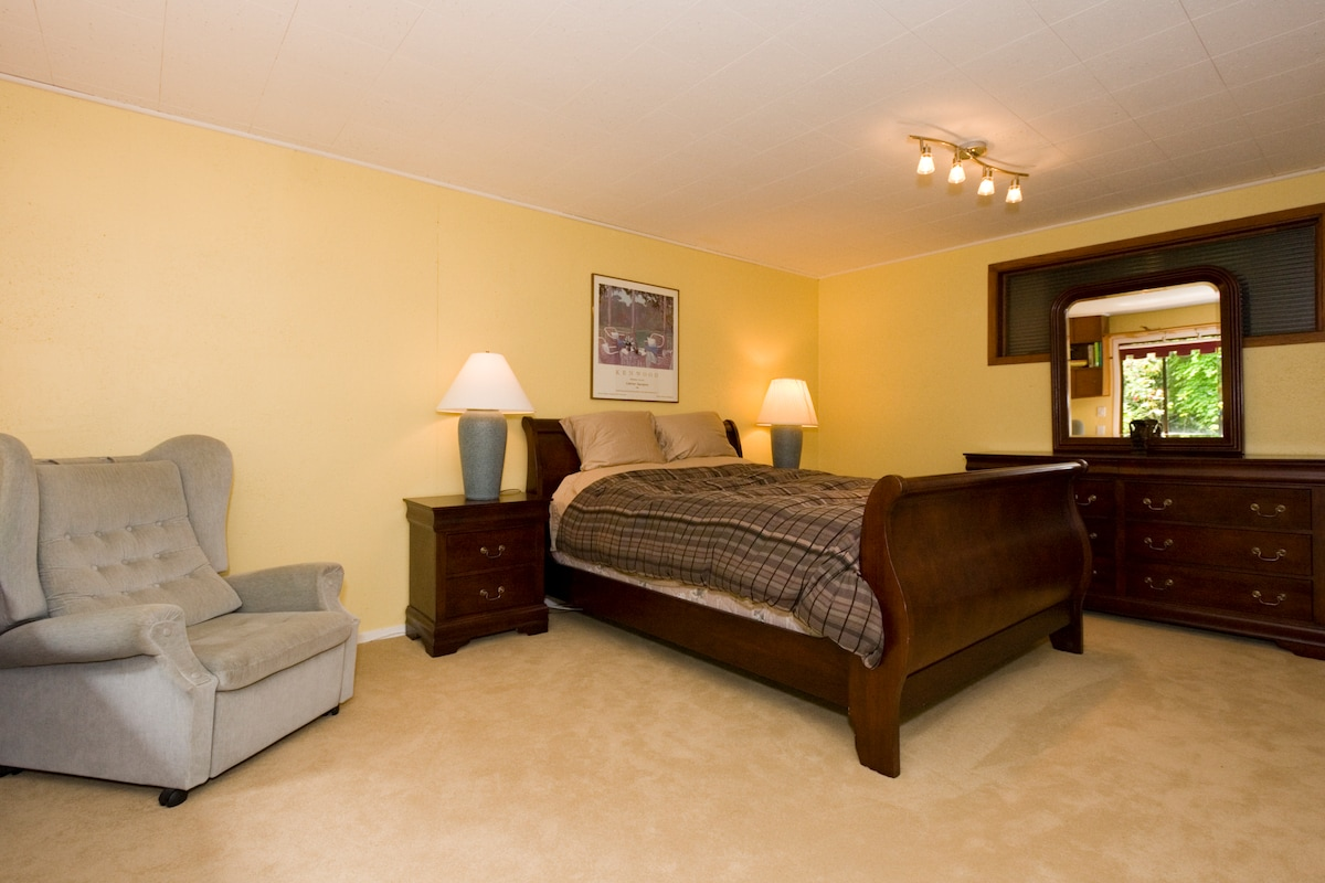 Queen bed with easy chair