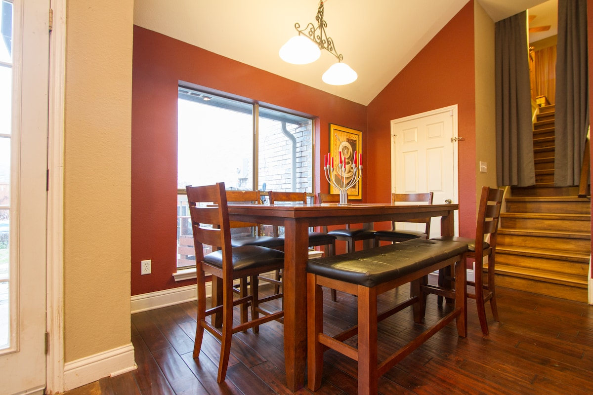 Dining area with seating for 8+ overlooking the backyard