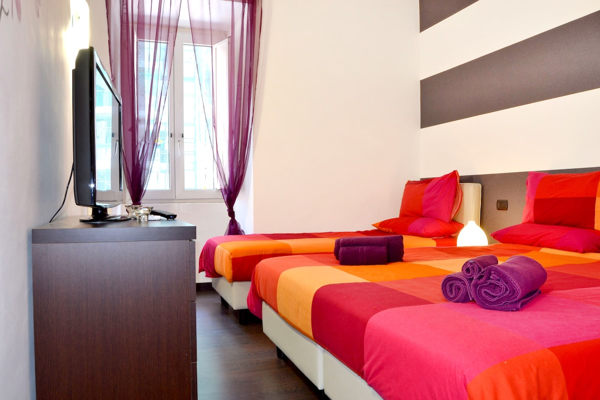Bedroom with double bed and single bed, tv
