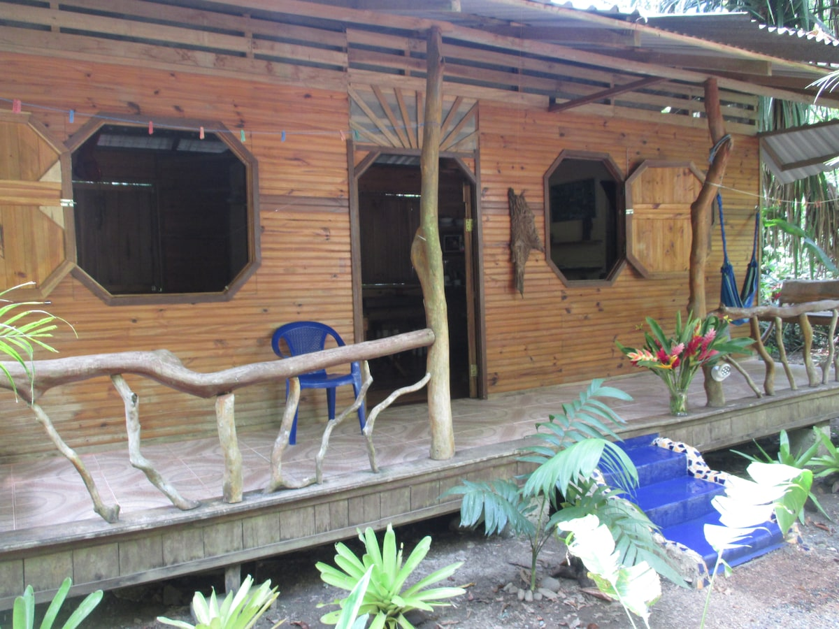 Front of Casita Tranquila, relax in the hammock with a garden view