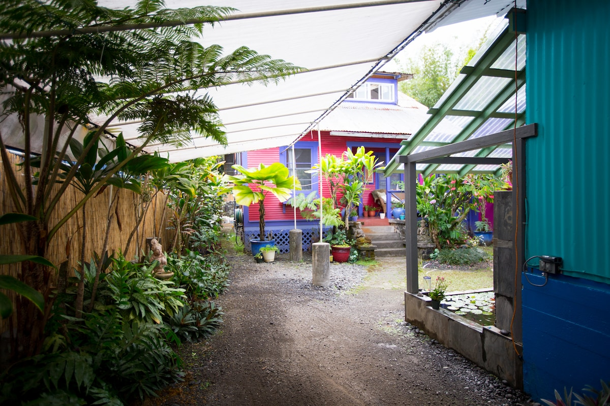 Enter from the street and find gardens, fish ponds and 2 refurbished 'shacks' from the old cane days..