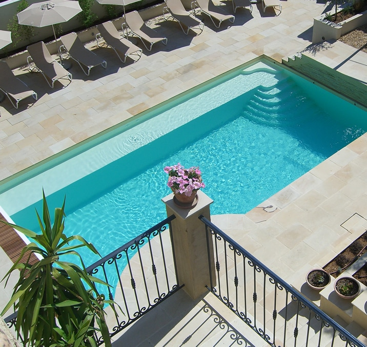 Lookng down on the pool from the 1st floor terrace, with the large sunbathing terrace and summer kitchen