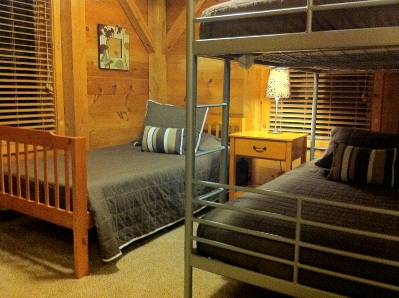 The upper middle bedroom features a twin bed and twin bunk bed. Sleeps three.