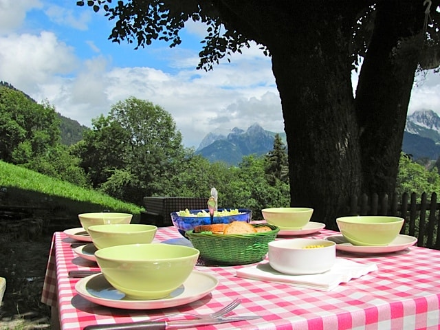 breakfast in the sun in front of the alps view an unforgettable peacefulness