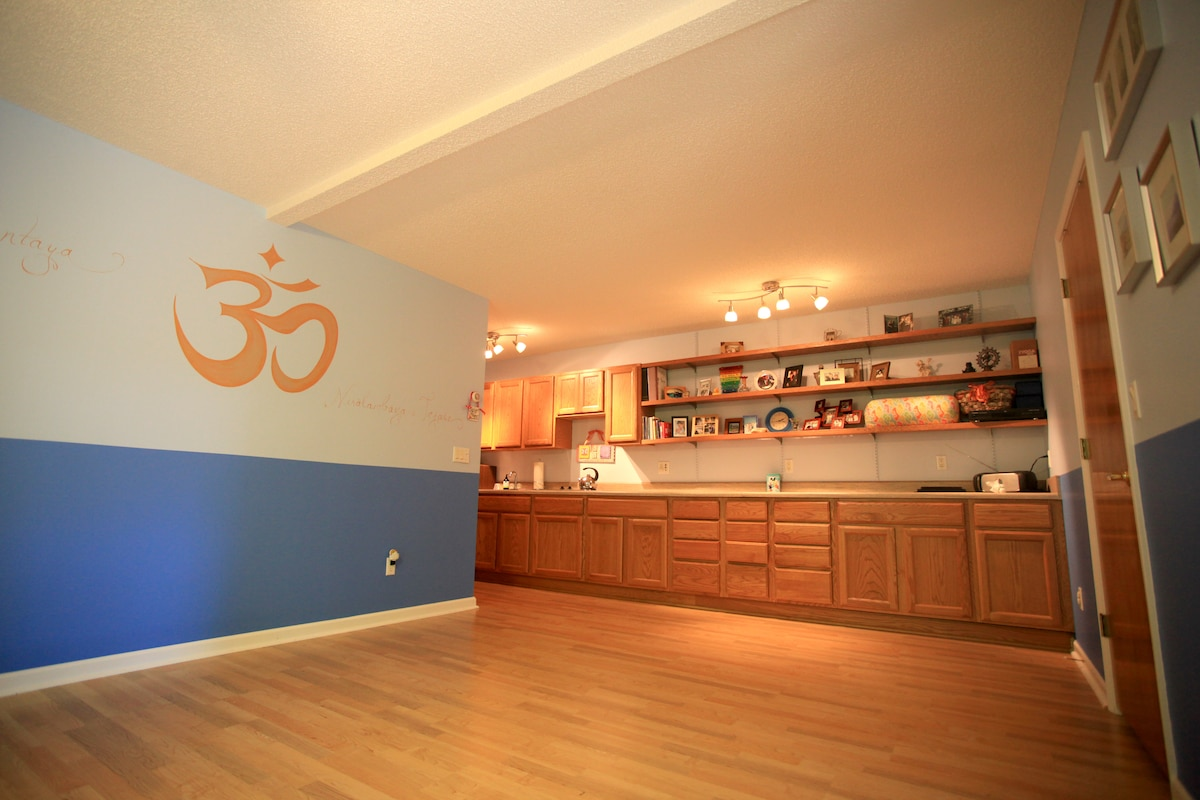 Yoga room, also has a treadmill. Stovetop and minifridge in the rear.