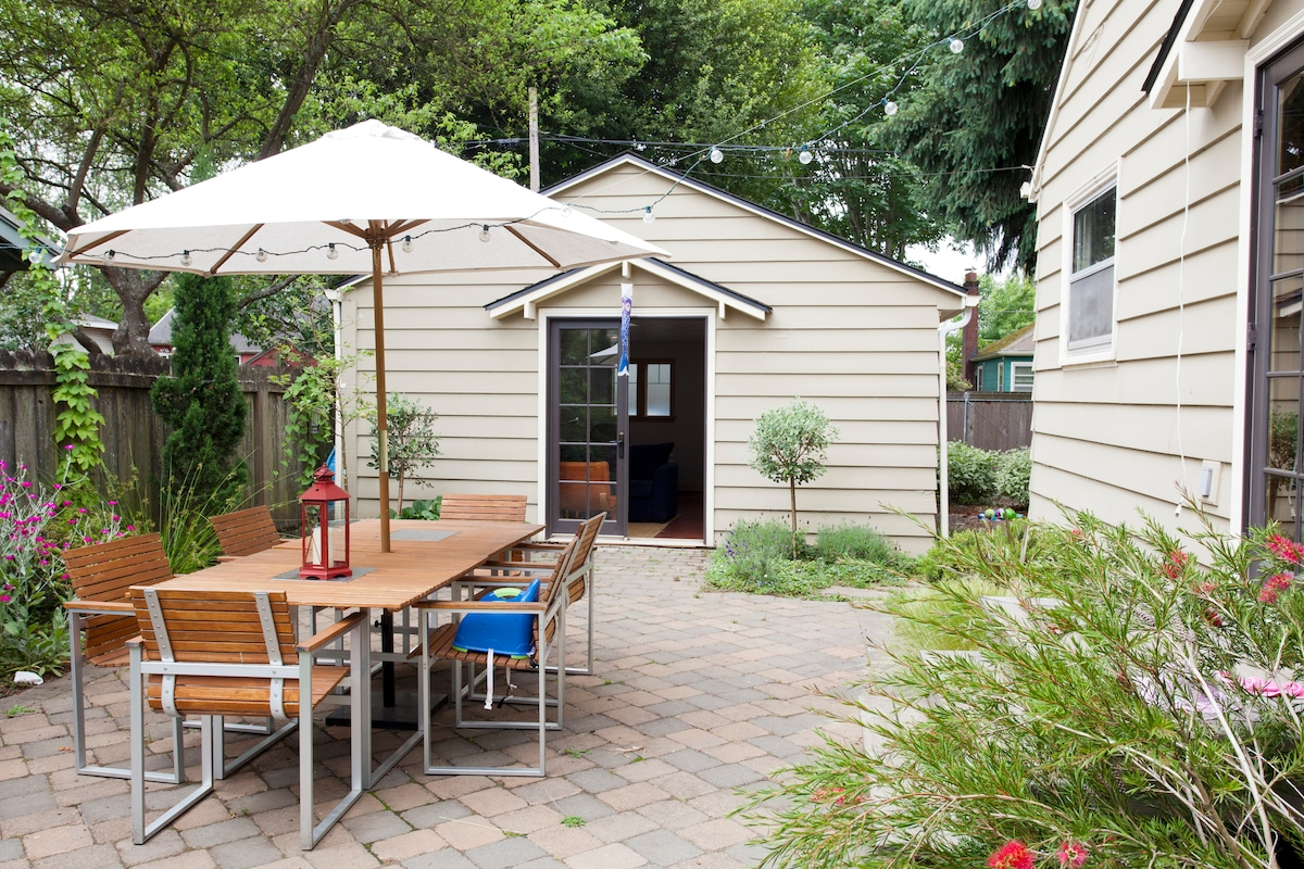 The studio with patio and seating for 8. That's our house on the right. We often only rent the studio when we are gone.
