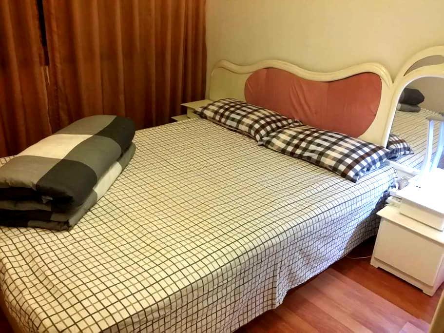 【旅游居住首选】卧室温馨舒适,小区环境优雅,交通便利。 - Liangshan Yizuzizhizhou - Квартира