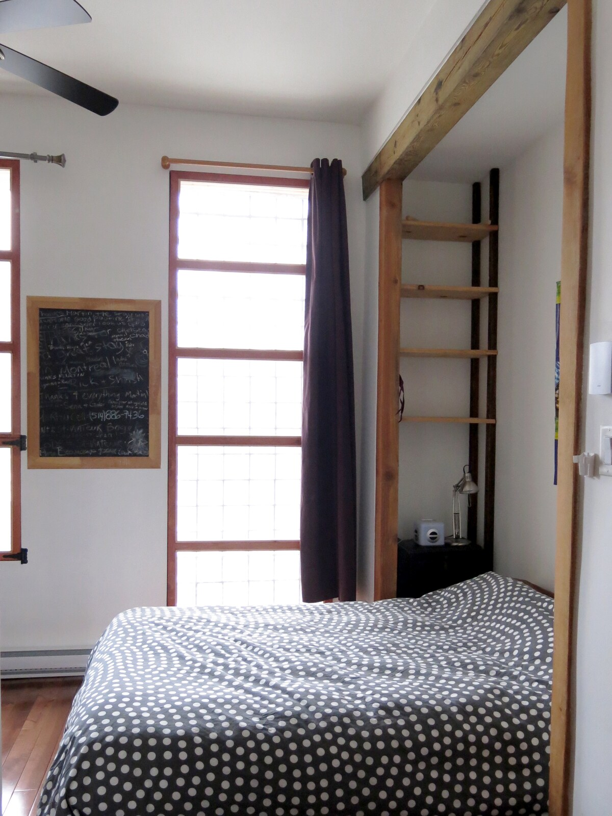 large windows in the second bedroom, exposed beams & shelves.