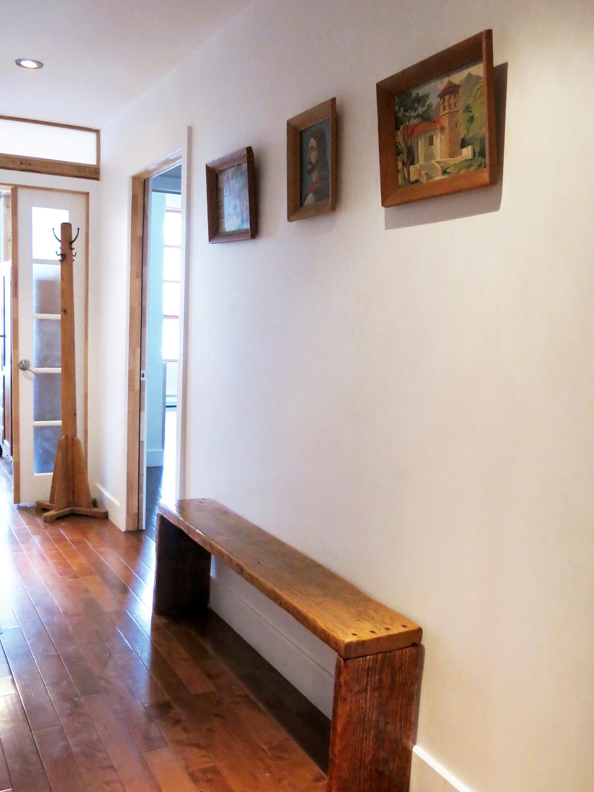 hallway with bench & coat rack.