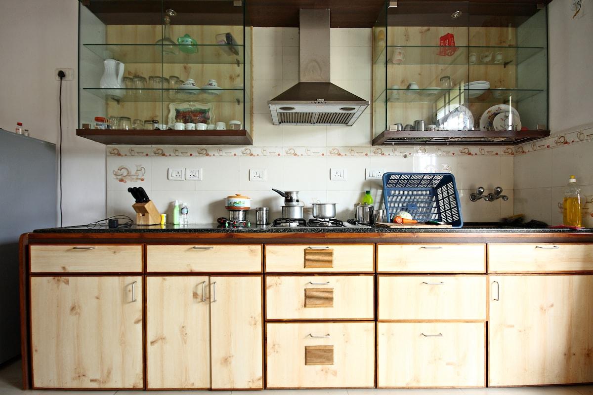 Kitchen cooking platform view with glass storage