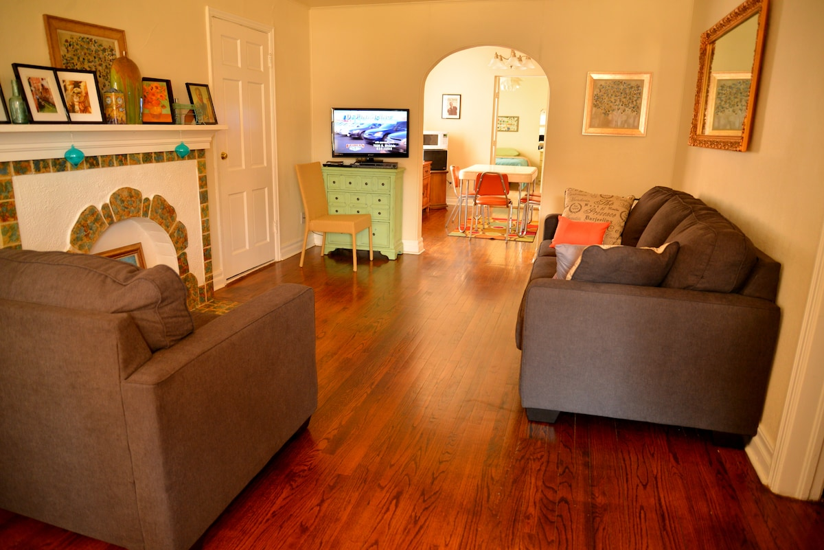 Tv room with new sofa and loveseat, original 1934 mantle. Dish TV programming and movies.o