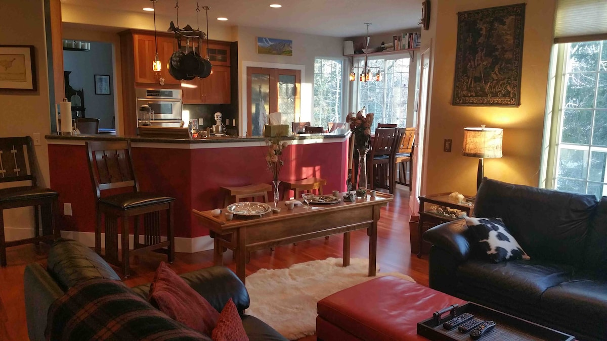 Family room with second fireplace and TV is just off the kitchen