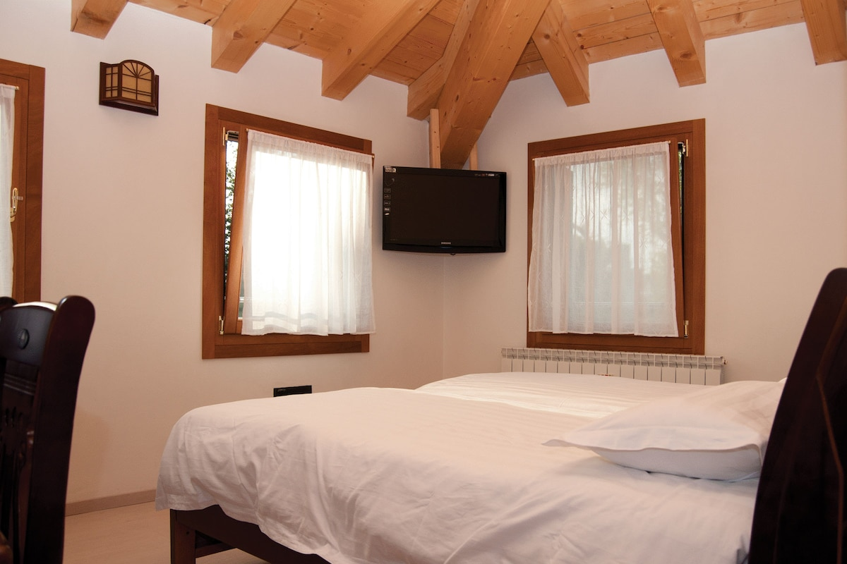 Beatiful room with two single beds and TV.
