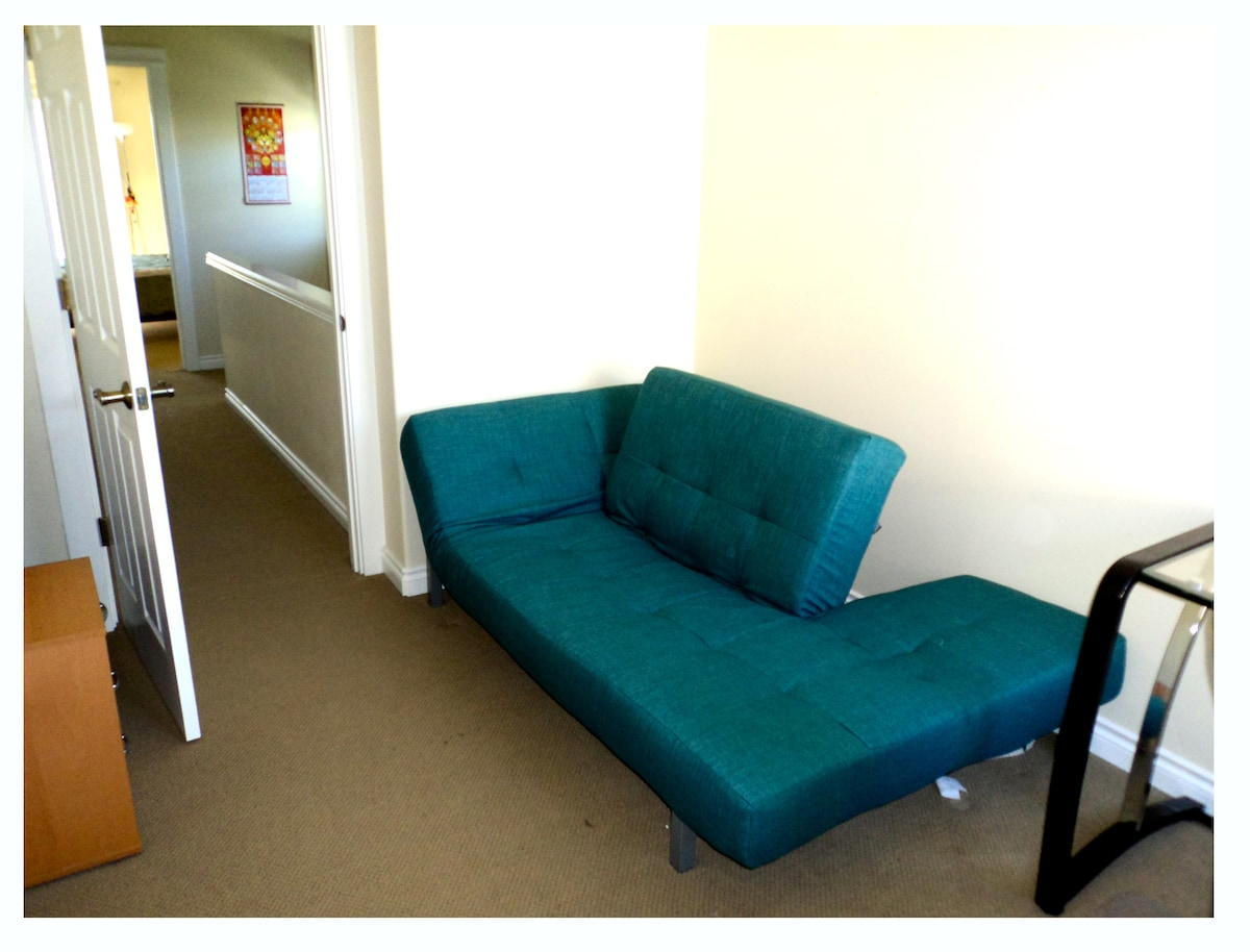 Office/guest bedroom upstairs. This futon has been replaced with a comfy pillow top bed.