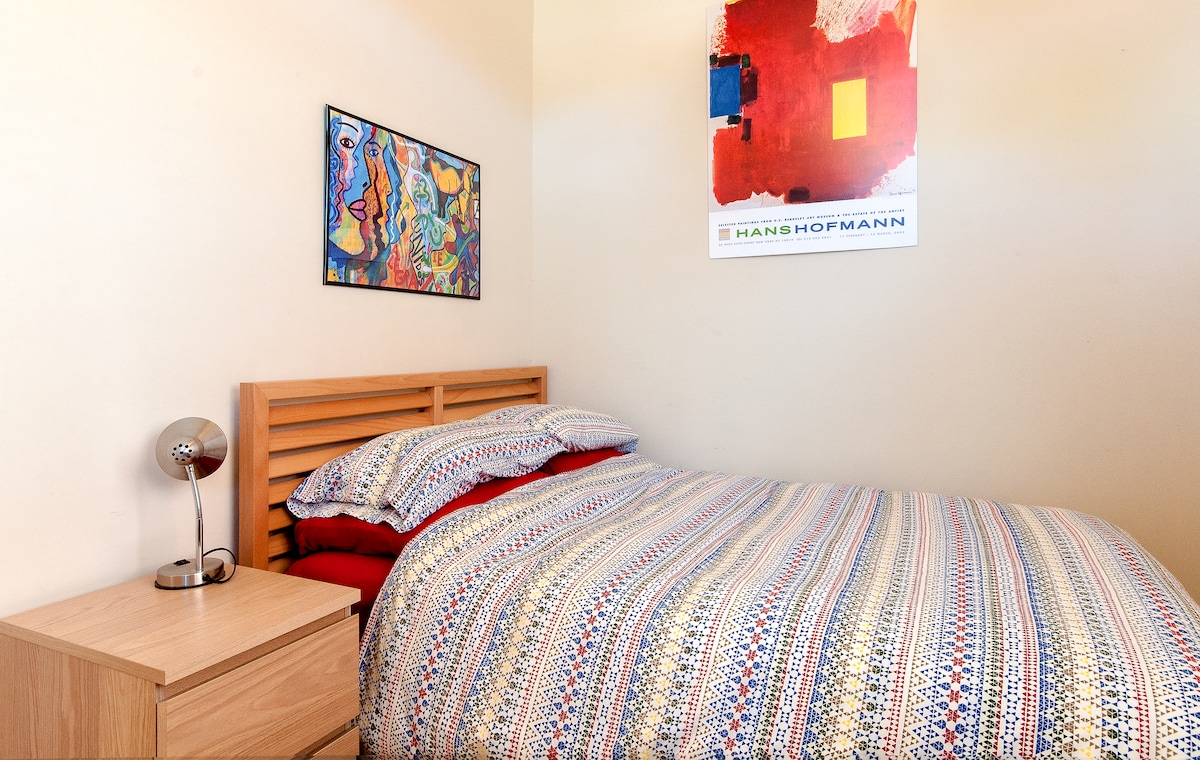 Your bedroom: Large bed with brand new mattress, lots of natural light, and a desk.