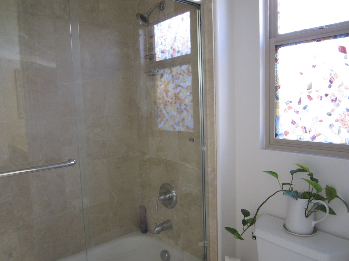 Full bath tub w/ shower & toilette (separate from sink area)