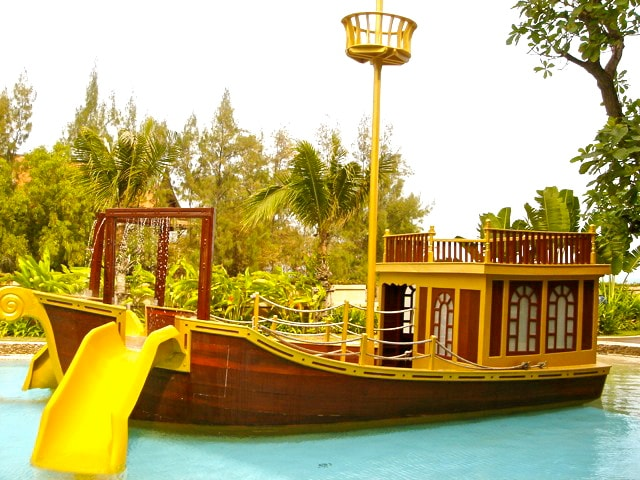 Children's pool with play area and slides