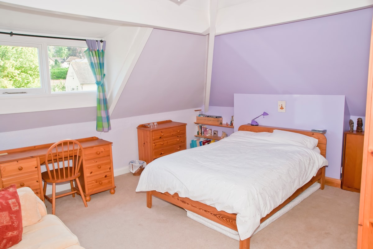 Double bedded room with view onto Cow & Calf rocks