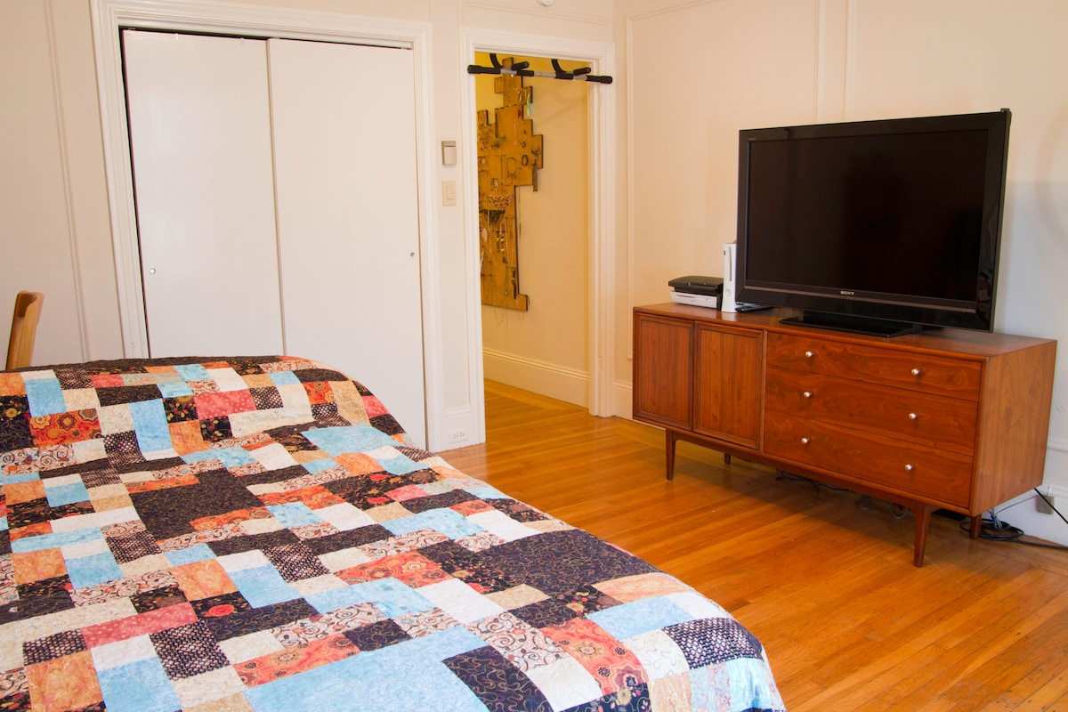 """Entrance to the bedroom/living space with nice view of a 46"""" LCD tv from bedside"""