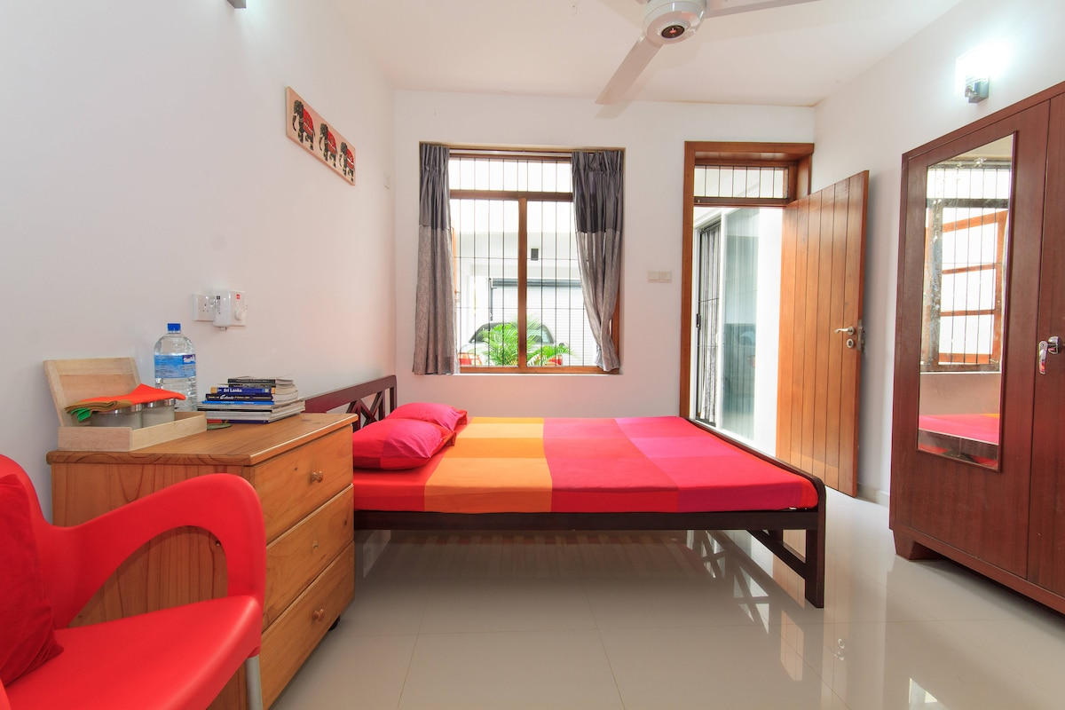 Queen size double bed with side cupboard and mini-bar refrigerator.