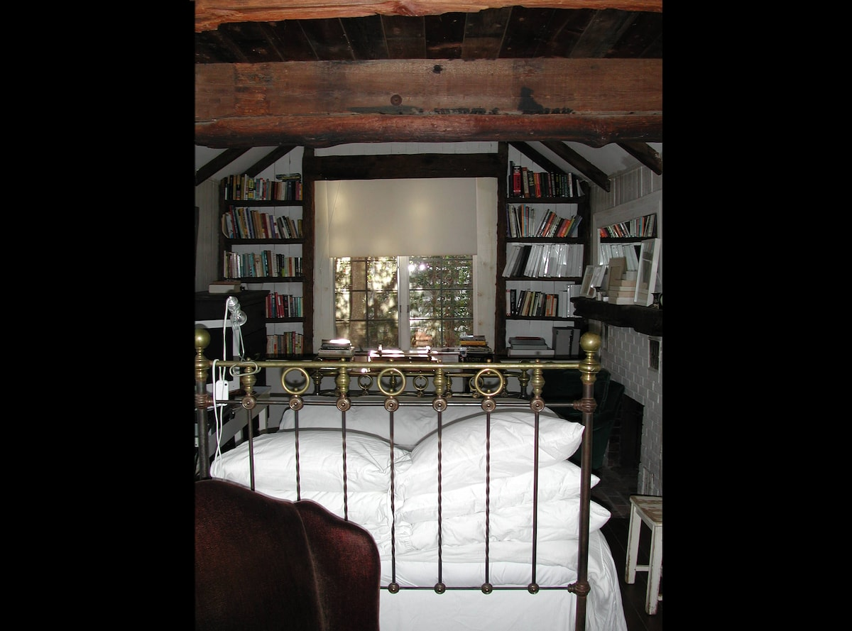 Cathedral ceiling - wooden beams from a sunken ship - down comforter - lots of books