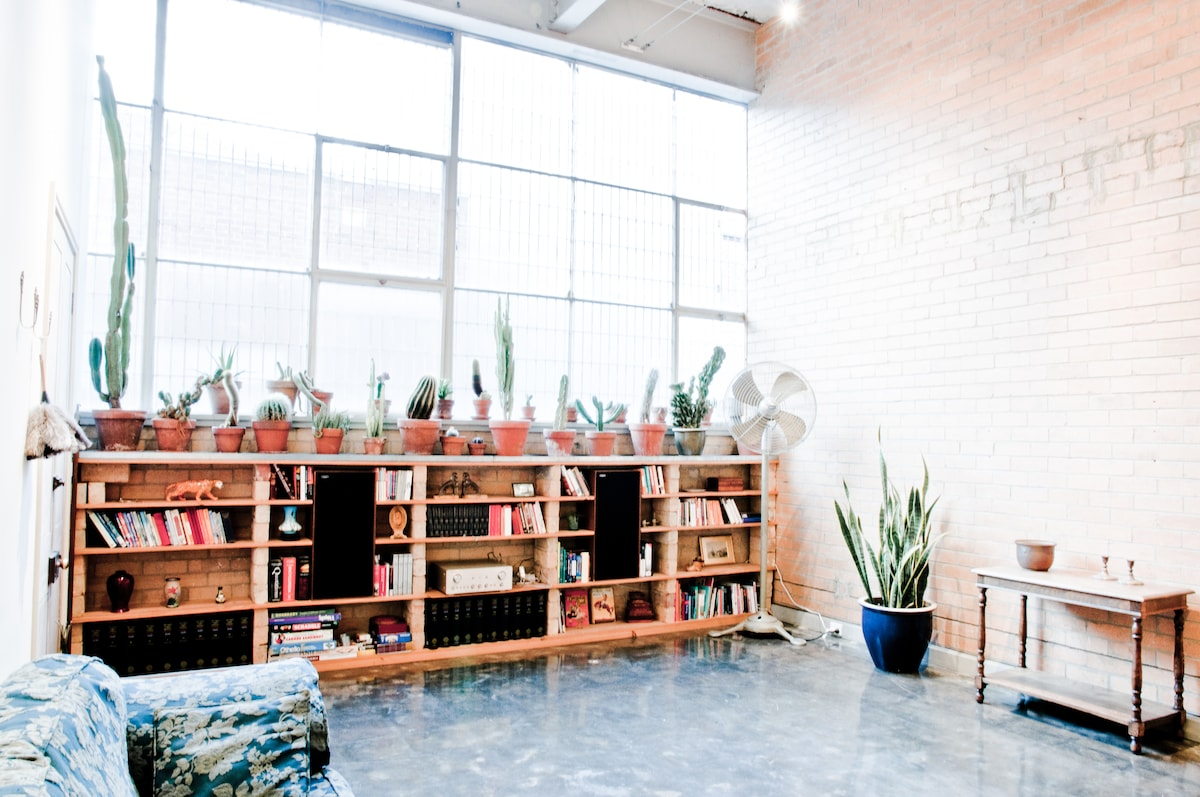 Wall of windows, exposed brick wall, polished concrete floors, Marantz and Celestion hi-fi (connects to laptop and mp3 players), books and reference material inc 20 volume complete Oxford English Dictionary