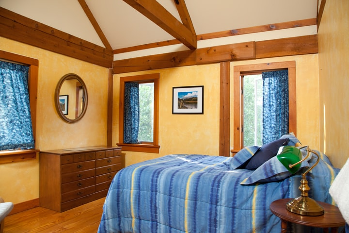High ceiling, four windows and track lighting offers a comfortable, relaxing room for your stay.