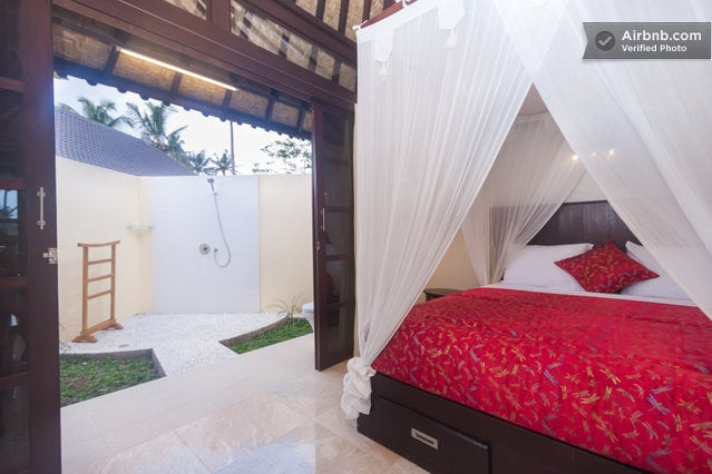 Queensize bedroom with daybed, and large deck surrounded by ponds