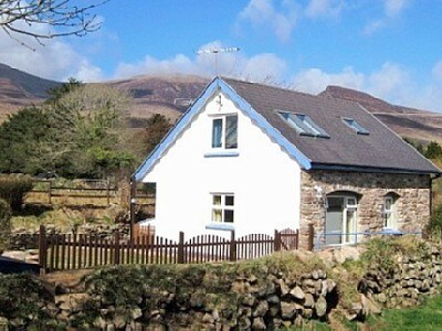 Annie's Cottage with Caherconree Mountain behind