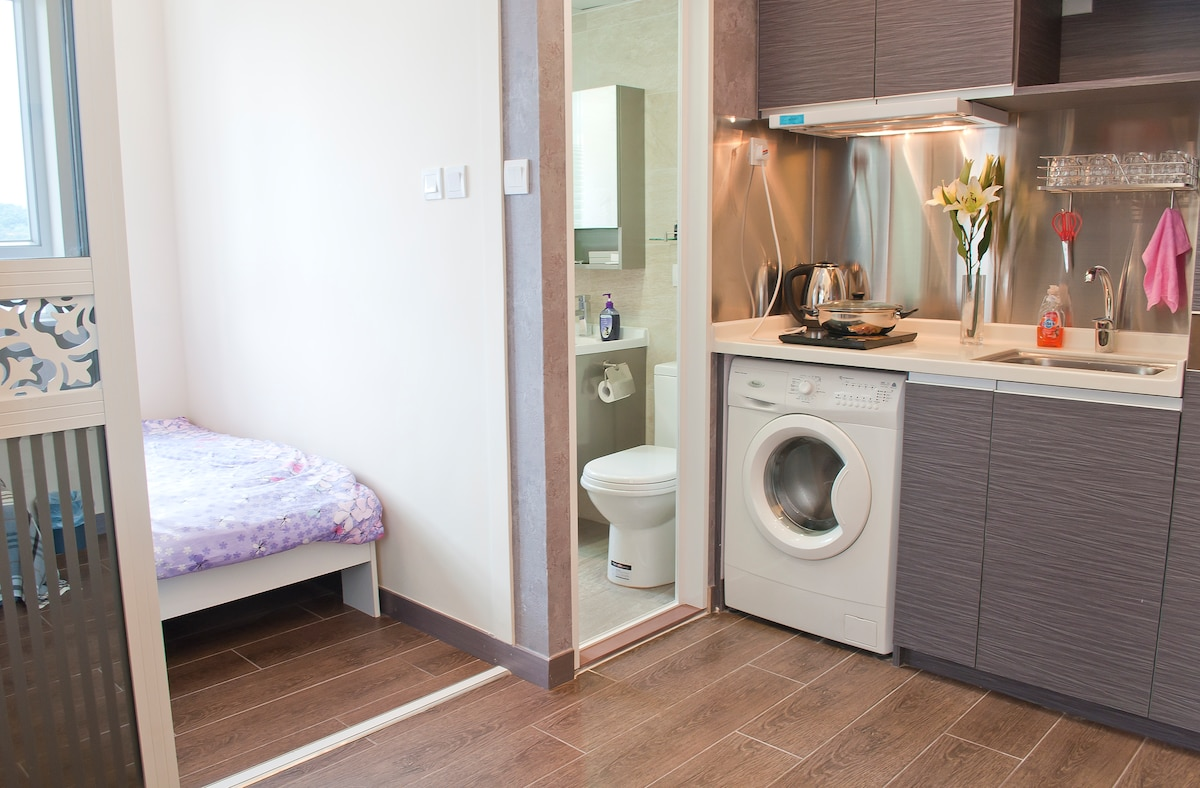 one modern kitchen with full facilities, wash machine, with a big bed room