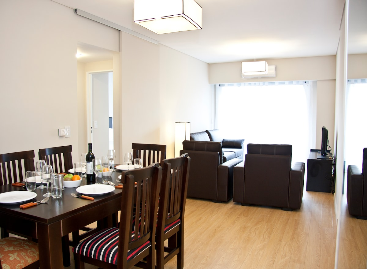 View of the dining and living room as you enter the apartment