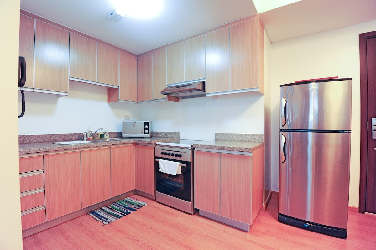 Fridge, 4 burner electric stove with oven, microwave, coffee maker, toaster, electric kettle, dinner ware, cook ware.