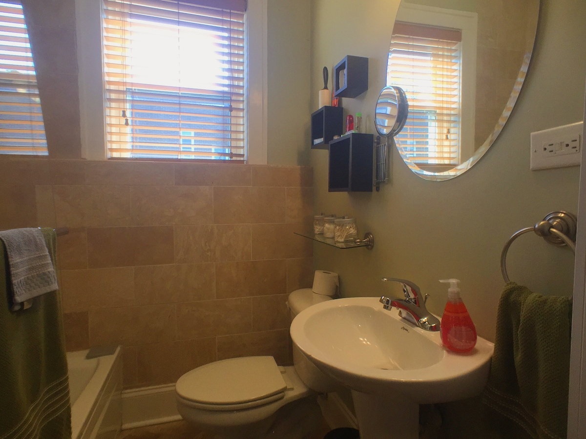 Heated Bathroom, exposed glass shower, tile finish, toiletries, hair dryer, and more.