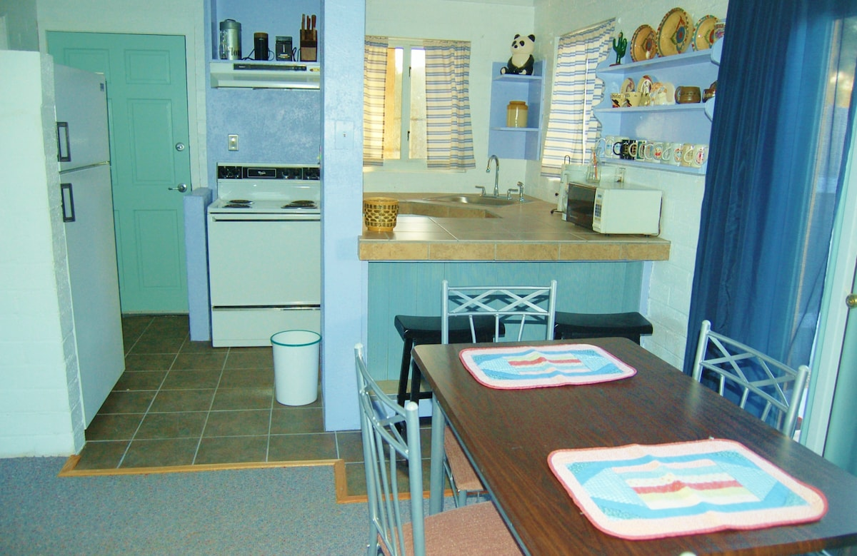 The kitchen opens to the screened porch.