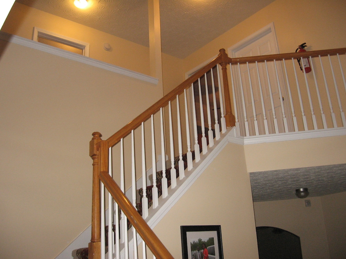 Front stairs to bedrooms and restrooms.