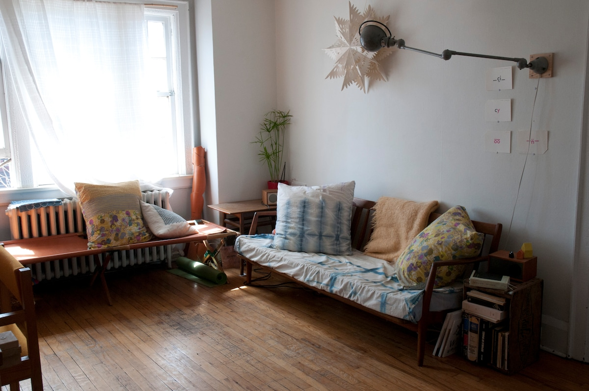 Cosy but spacious, the living room is big enough to practice yoga and you'll find a mat right under the leather cot!
