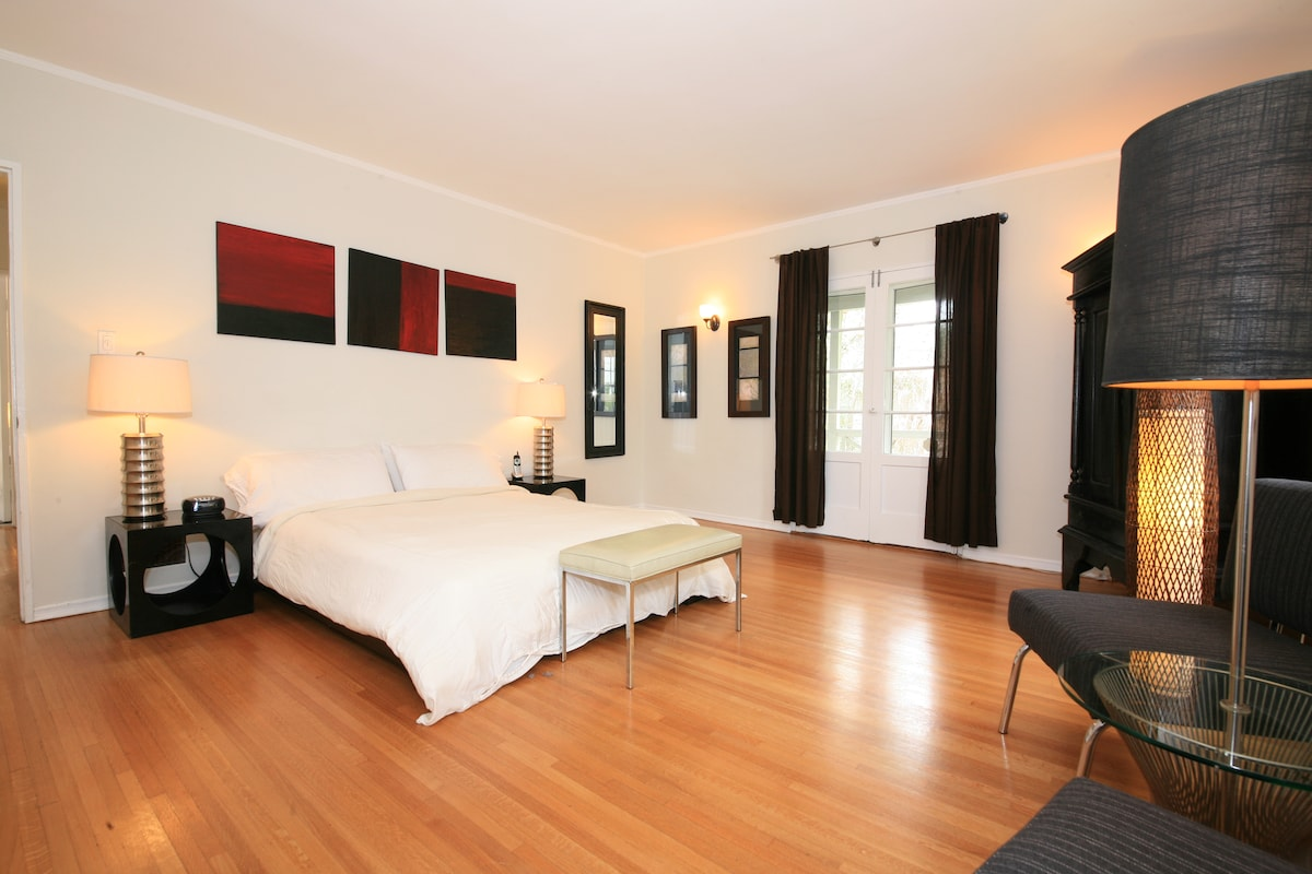 The very large master bedroom. Note the doors out to the private balcony.