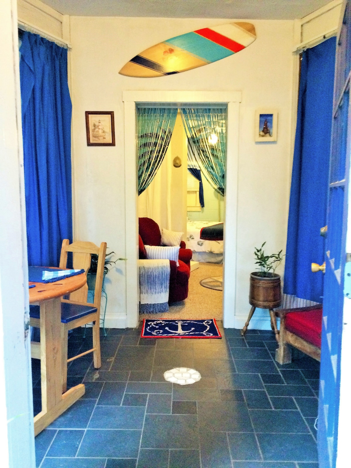 Solarium entrance, dining table and entrance to living room.