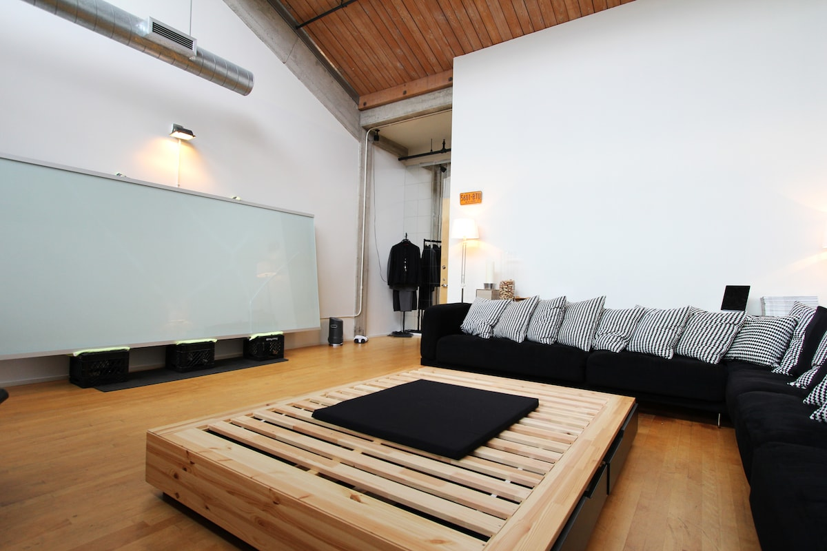 Grand Room with huge couch and whiteboard