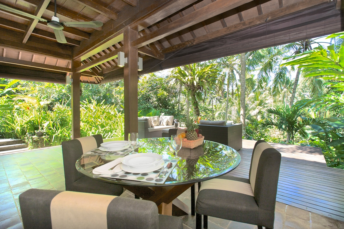 Open living and dining area, with cover for the few rain showers that keep our gardens green and jungly.