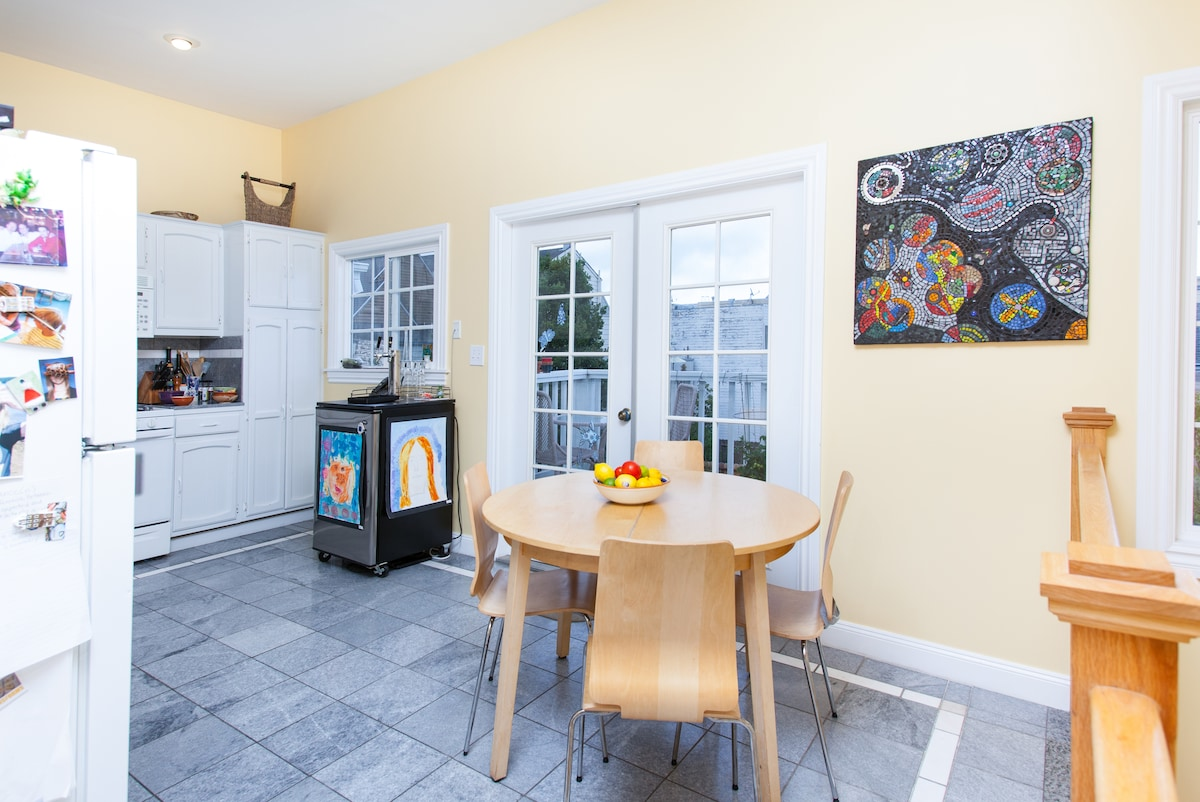 Large and airy kitchen with french doors leading to new deck