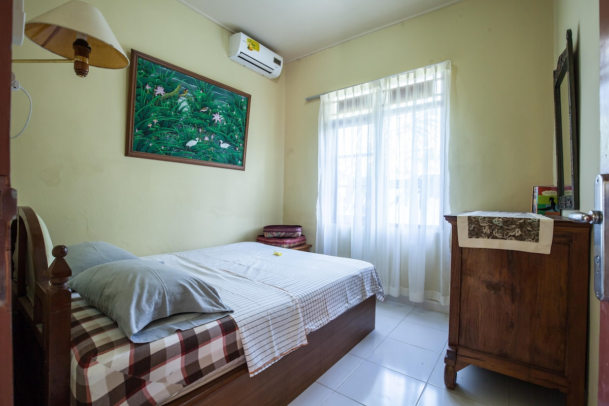 Private Bedroom 1, queen size bed with Aircon, front garden view