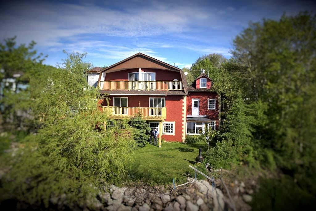 Former B&B Honeymoon Suite on the water's edge. - Granville Ferry