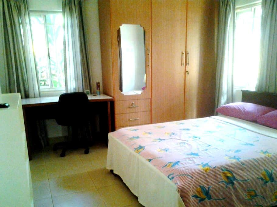 En suite room in family home - Accra