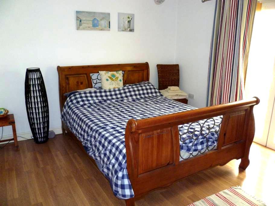 Buckley: King sized bedroom.  - Buckley