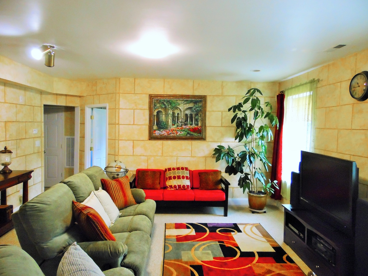 Your living room, a reclining sofa and cable with HD TV